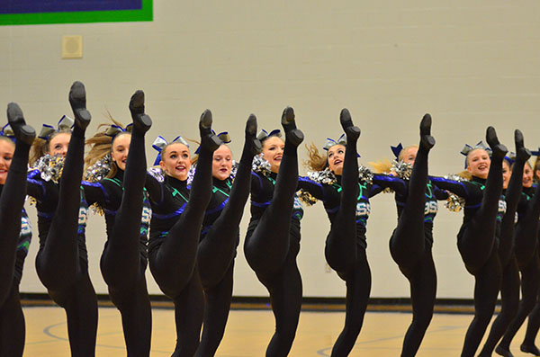 Touch of Silver performs a competition routine at a home basketball game on Thursday, December 8. They performed the same routine at a competition on Saturday, December 10.
