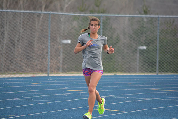 Tori Findley runs during practice, preparing for the first meet of the season. Photo by Emma Anderson.