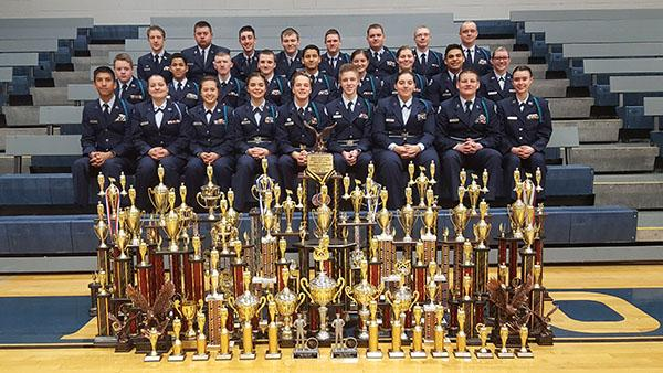 Members of the Blue Springs South Air Force JROTC drill team pose with trophies they have won at competitions this year. They have competed a total of eight meets throughout the school year. Photo submitted.