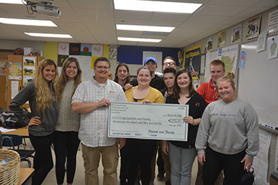 Student planned auction to help South teacher