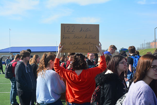 Sophomore Cordelia Williams holds a meaningful sign. She is an active believer in gun control. Photo by Colton Robertson