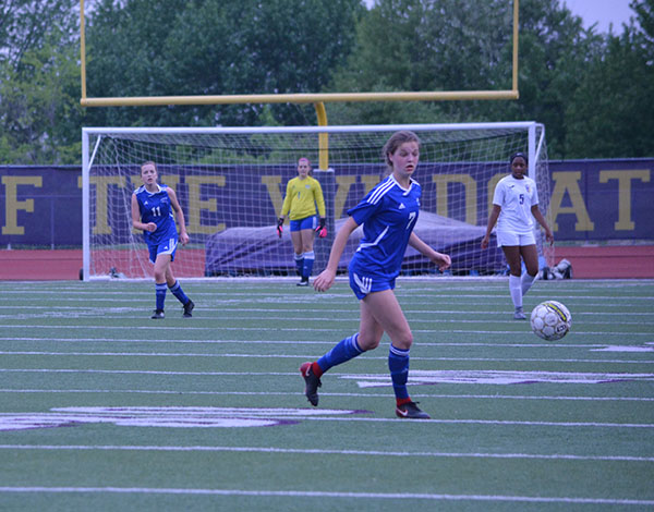 Sophomore Brie Severns chases a ball in a game against Blue Springs on May 8th. Severns was named to the Elite 11, an award honoring talented metro soccer players. Photo by Russell Baker.