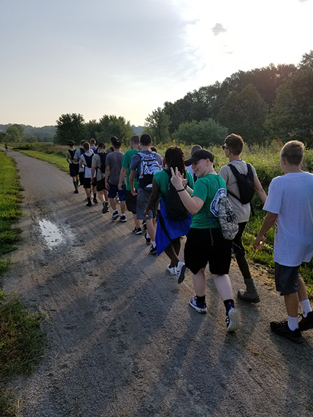 Cadets in the Blue Springs South Air Force JROTC program march along the Little Blue Trace in remembrance of the Bataan Death March during World War II. Photo courtesy of BSSHS Air Force JROTC