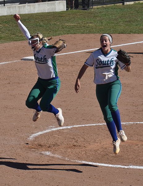 Easton Seib, left, and Addie Lightner celebrate as the Jaguars record the last out of the Class Four softball state championship game on  Saturday, Oct. 27, 2018. The Jags beat Troy Buchanan 2-0 to win South's first state title in softball.