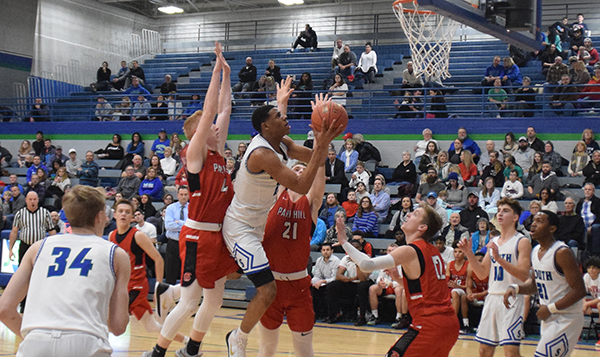Jaylon McDaneil goes up for a layup against Park Hill Photo by Austin Poynter