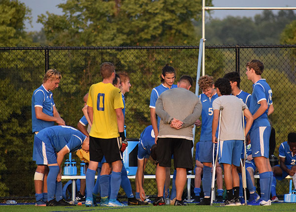 Members of South's varsity soccer team in a huddle before a playing a home game against park hill. Photo by Shyia Patrick