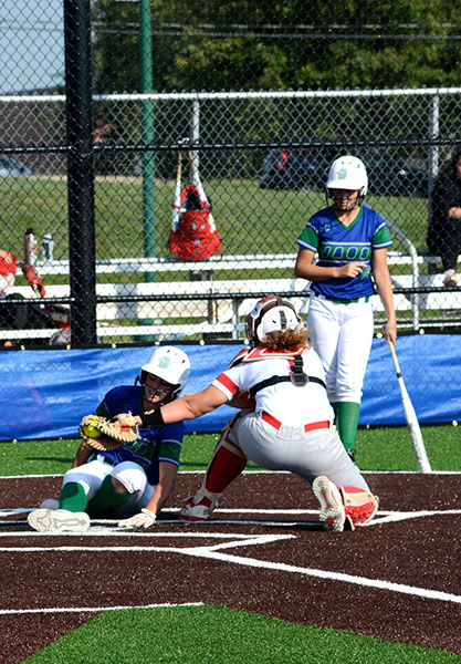 Blue+Springs+South+player+slides+into+home+after+another+player+steals+from+1st+base+against+Park+Hill.+Photo+by+Gage+Campbell