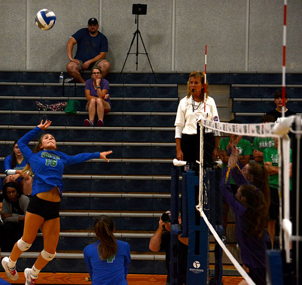 Kylie+Gregory+goes+up+for+a+spike+to+score+against+their+town+rival+Blue+Springs+High+School.+Photo+by+Gage+Campbell