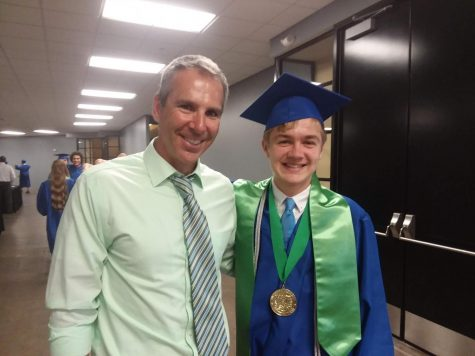 South social studies teacher Kyle Plummer poses with graduate Nate Henks after the 2019 graduation ceremonies. Plummer was named South Teacher of the Year in March and the Blue Springs School District Teacher of the Year in May. Photo courtesy of Kyle Plummer